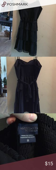 Black ruffled AE dress Black fitted American eagle dress with ruffled skirt ribbon tie around waist size 8 very pretty and light American Eagle Outfitters Dresses