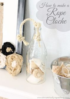 DIY Rope Cloche - perfect to showcase your shells! So cool!  Cut off the bottom of a bottle to create your own cloche.