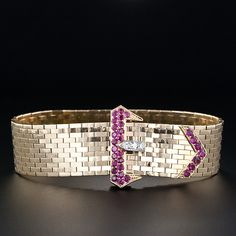 """1940s bracelet with rich red Burma rubies and diamonds on the buckle and a lithe and flexible brick motif 'belt'. This style of bracelet, called the """"Ludo,"""" was coined by Van Cleef and Arpels in the 1940's."""