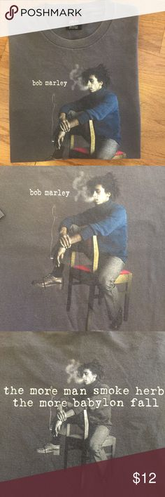 """Bob Marley T-Shirt Zion Rootswear, Bob Marley T-Shirt. Size L... short sleeve... color is grey, 100% Cotton. Made Mexico 🇲🇽 """"the more man smoke herb, the more Babylon fall."""" EUC !!  Bundle and $ave... check out similar names in my Closet. Zion Roots Wear Shirts Tees - Short Sleeve"""