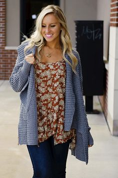 Cuddle up for colder weather with this cozy cable knit cardigan! It's a great neutral color that pairs easily with any outfit!