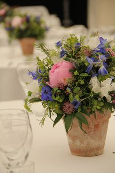 vintage terracotta pots with your floral in each