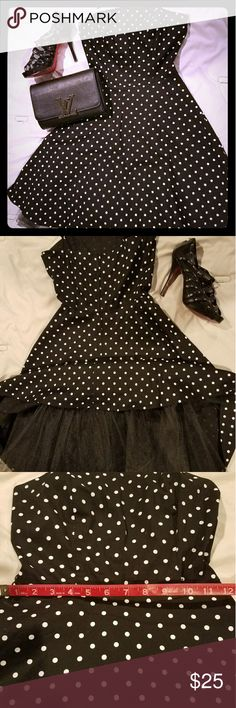 Black and white polka dot Dress This is a gorgeous retro dress with tule. Can be worn with heels, flats, or sneakers. Very versatile and easy to dress up or down. Prices negotiable. This is my first listing, starting with beautiful dresses my daughter is moving on from. finesse Dresses Midi