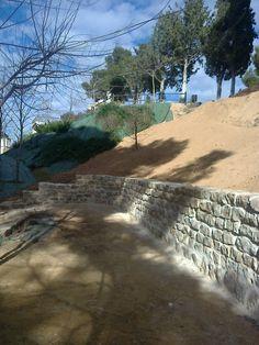 Finalización de muro y talud.