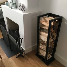 Indoor firewood storage: more than 40 log rack ideas to store firewood in style! Firewood Stand, Indoor Firewood Rack, Firewood Storage, Small Fireplace, Fireplace Design, Steel Furniture, Home Decor Furniture, Log Home Interiors, Home And Living