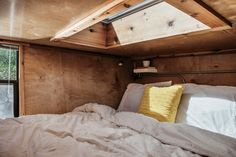 The sleeping loft features a Velux skylight. Structural insulated panels by Vantem keep heating costs down in almost any climate.