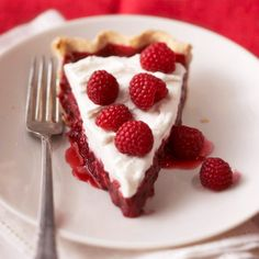 Raspberry Pie covered with a cream cheese and whipped cream topping.