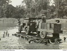 Jeep and trailer being floated across a river by Australian troops using an improvised raft made of wood and empty barrels, Henry Reid Bay, New Britain Island, 20 March 1945