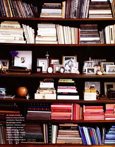 All the photos gathered on one shelve and the rest just stacked is organized AND easy!