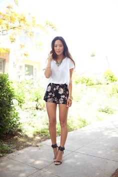 White tee, floral prints shorts and strap sandals for fab summer style