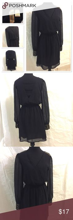 Whispers black long sleeve dress sheath size S Whispers black long sleeve dress sheath size S. Great condition. New without tag. Gold metal studs on shoulders and cuffs Whispers Dresses Mini