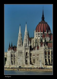 Towers of the Parliament, de Eclectic Parliament Building, building began in 1885, stretching along de Danube Bank. De Hungarian Holy Crown n de coronation jewels r exhibited in de Dome Hall. De building is home to de public Parliamentary Library, in Budapest_ West Hungary