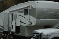 "Our ""new"" home - a 5th wheel trailer and a Ford F-250 4-door truck. No more towing a vehicle everywhere!"