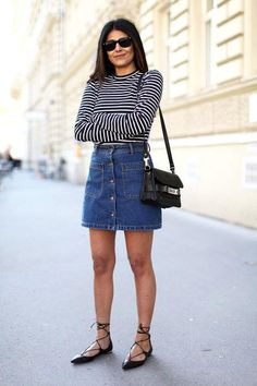 Fashion Landscape in a denim skirt, striped shirt, and black flats