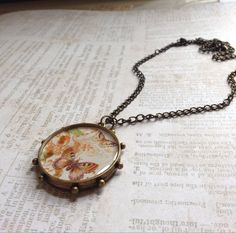 Butterfly Bezel Necklace by TLCadornments on Etsy