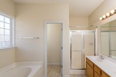 117 Briar Hollow Drive Jacksonville, NC by JG Homes, INC  |  Double vanity, separate shower and soaker tub in the master bathroom.