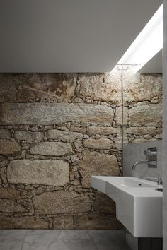 walls and lighting and mirror... stone treatment applicable to many places (inside/out, walls/walks)... natural, indirect light beats electric every time!  allows for hidden fluorescents (or other low-v) for nighttime use... flush mirror illusions greater space
