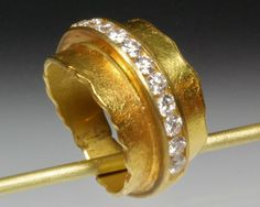 Thick, textured 22K gold band with channel-set diamonds in 14K gold.  Three different weights available.