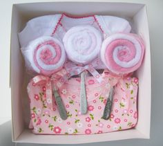 washcloth lollipops with baby spoon sticks...such a cute idea!