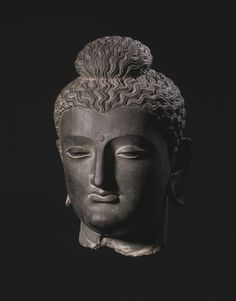 A MONUMENTAL GRAY SCHIST HEAD OF BUDDHA ANCIENT REGION OF GANDHARA, KUSHAN PERIOD, 2ND / 3RD CENTURY