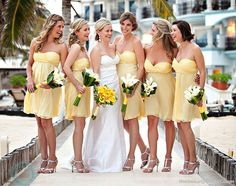 the color scheme i want for my future wedding! pale yellow bridesmaids dresses with white flowers and white wedding dress with yellow flowers :)