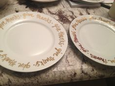 Easy plate DIY, Crate and Barrel look alike on the left! Gold sharpie paint pen, bake at 350 for 30 mins. So fun!