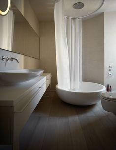 white-shades-define-luxurious-multistory-milan-apartment-13-shower.jpg