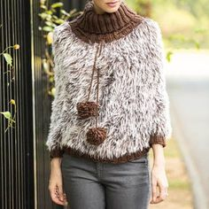 On the Prowl Poncho FREE knitting pattern | AllFreeKnitting.com - Furry poncho w/ ribbed turtleneck and pompom strings