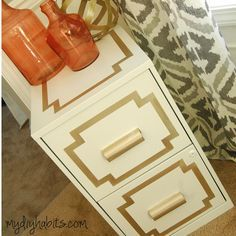 Glamorous File Cabinet Makeover -- Use alcohol to clean, prime, paint top and front with gold, let dry, then tape the design out, then paint with Martha Stewart's Golden Pearl. Done!!!