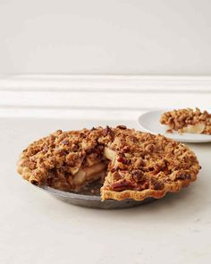 Apple Pecan Pie | Martha Stewart Living - A hybrid of two of our favorite pies, this makes a delicious Thanksgiving dessert, especially if you top it with some freshly whipped cream or vanilla ice cream.