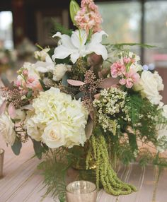 Blush pink, green, and white centerpiece. View more blush wedding inspiration from Knoxville wedding florist @melissatimm! Pic: Break the Mold Photo | The Pink Bride www.thepinkbride.com