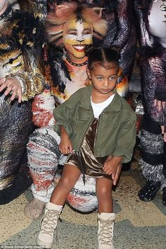 Feline bored: North West looked unimpressed with the cast of Cats in Broadway on Sunday