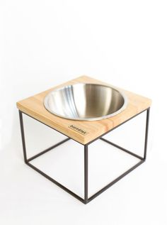 "This single midcentury modern dog bowl ""M-MOD"" was designed for the midcentury design enthusiasts/pet lovers. Perfect for medium to larger sized dogs."