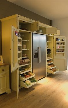 If you've got the space, here's an ingenious idea: build your pantry around your fridge, with plenty of pull-out drawers and door shelves. It will speed both your grocery unloading and your food prep time.