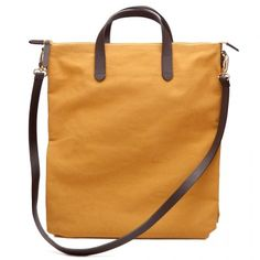 """Our new canvas laptop bags are going fast! Perfect for toting your laptop to work or around the city, our bag is spacious enough for a 15"""" computer and all your work essentials. Get one before they're gone!"""