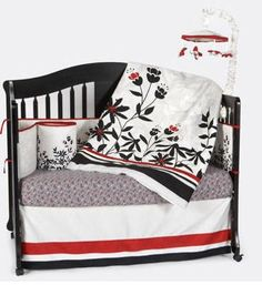 Black, white and red organic baby crib bedding and nursery decorating ideas. We used the black, white and red nursery bedding set that you see in the pictures as the foundation for our baby boy or girl's nursery. The color scheme