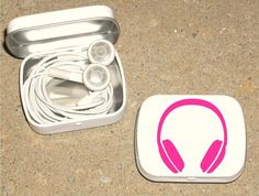 repurposed altoid tin to keep earphones from tangling...need to do 3 diff colors for each kid