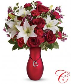 """""""Heartstrings Bouquet."""" Wow her with this lovely bouquet of red roses and white lilies. Beautifully arranged in a lustrous red ceramic vase, featuring a silver-plated heart pendant with a 1-carat SWAROVSKI® ELEMENTS crystal - it is the perfect 3-in-1 gift"""