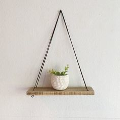 Even prettier if your plant drapes over the sides of the shelf. Get it for $30 here.