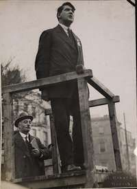 [Side view of Michael Collins speaking from podium, right arm raised: an unidentified person in the. Ireland 1916, Easter Rising, Michael Collins, The Republic, Side View, Ui Design, Dublin, Celtic, Irish