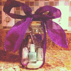 Mason Jar gifts. Never thought of gifting in a mason jar!  So cute! Fill this baby to the top!! Add candy to the top, after placing a piece of wax paper between the candy and the other goodies or bag the candy, dress it up pretty and place it on top of the other gifts!
