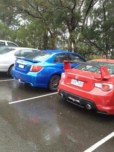 Red Toyota 86 with aero kit from behind vs a blue mica Subaru wrx. The 86 wins every time :)