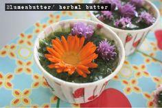 Homemade herbal butter with eatable flowers. Selbstgemachte Kräuterbutter mit essbaren Blueten.
