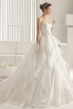 Brides: Rosa Clar�. Dress with corded lace body, beading, and organza skirt with hemstitch detailing in a natural color.