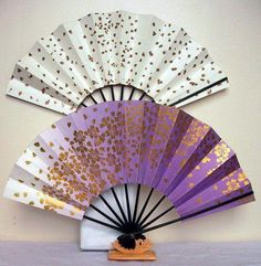 Folding fans - I like the purple one on the bottom.