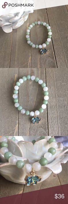 Moonstone and Green Jade Bracelet I designed this stretch bracelet with the intention of bringing peace, luck, and new beginnings to the wearer. Features natural green Jade and Moonstone. handmade Jewelry Bracelets