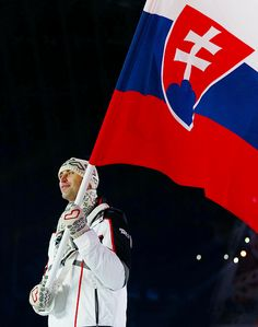 Zdeno Chara holding the Slovakian flag at the 2014 Olympic Games opening ceremony