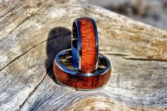 This bold and stylish 8mm men's ring is hand crafted in durable titanium with a hand polished finish. The koa wood inlay adds vibrant color to the unique ring style. Our sustainable koa wood is a Hawa