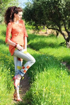 Spicy pumpkin, laced orange top, striped jeans and salmon heels