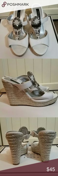 White house black market White and Silver wedge Leather upper with silver and pearl beaded detail. Wedge has a metallic silver thread throughout.  Left front has slight wear as seen in photo.   Do not have box or duster cloth White House Black Market Shoes Wedges